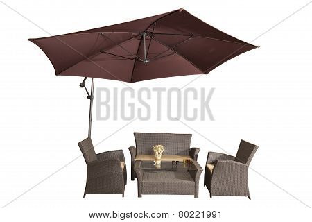 Set Of Rattan Garden Furniture Under A Big Garden Umbrella Isolated On White