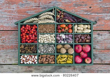 Various  Healthy Fruits, Seeds And Dried Food Ingredient  In Wooden Box