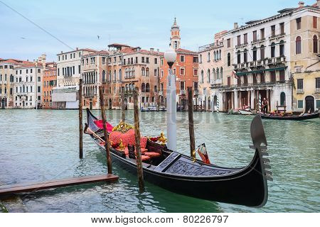 Gondola Parked In Water Canal