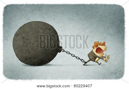 businessman chained to a large ball