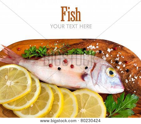 Fresh Fish On Wooden Board