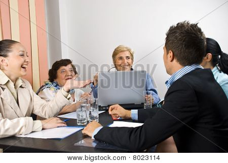 Happy Conversation At Business Meeting