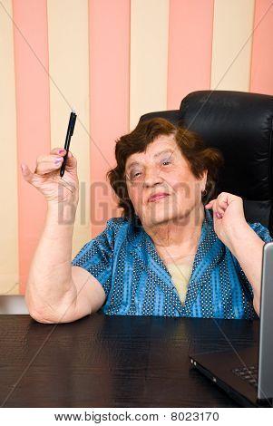 Elder Business Woman Holding A Pencil