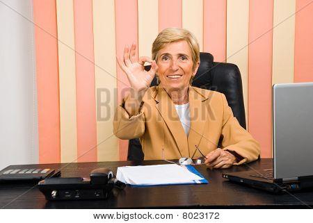 Happy Senior Businesswoman Showing Okay Sign Hand