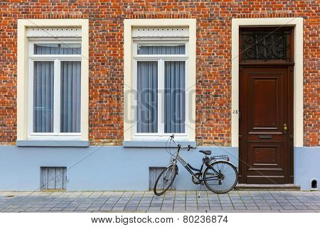 Scenic city view of Bruges street with bike