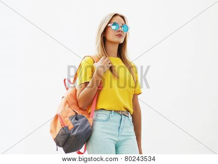 Street Fashion Concept - Stylish Hipster Girl In Sunglasses Outdoors Against The White Wall