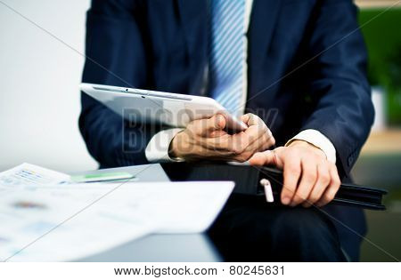 Businessman hands are holding the touch screen device.