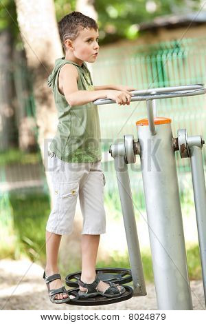 Boy Doing Fitness Outdoor And Having Fun