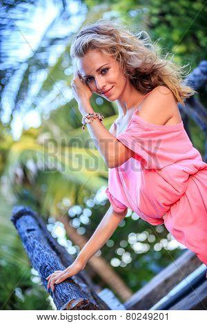 Blonde Woman Posing In Pink Dress