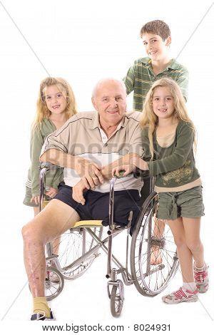 Grandchildren with Grandfather in wheelchair