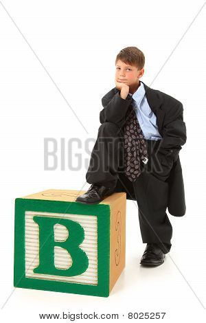 Boy In Suit With Alphabet Block