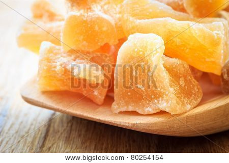 Closeup Candied Ginger On Wooden Spoon