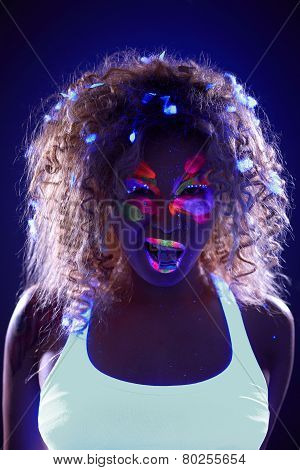 Portrait of pretty girl with candy in neon light