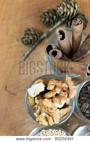 Glasses of  spices, cinnamon, nuts, allspice, sesame on a wooden board