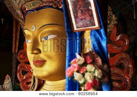 close up colorful sculpture of Maitreya buddha at Thiksey Monastery, Tibetan Buddhist monastery in L