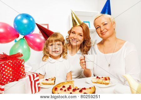 Happy birthday with little girl mother and granny