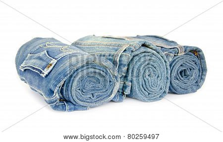 Roll Blue Denim Jeans Arranged On White Background