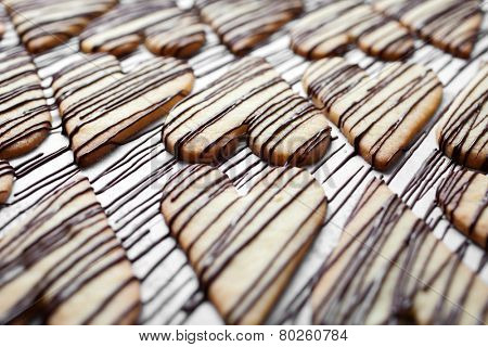 Heart shape cookies with milk chocolate stripes