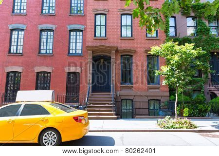 West Village in New York Manhattan building yellow cab USA NYC