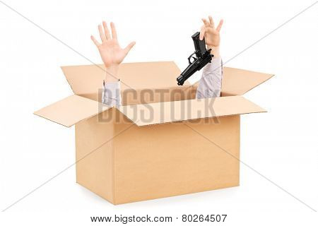 Hands surrendering gun and peeking from a box isolated on white background