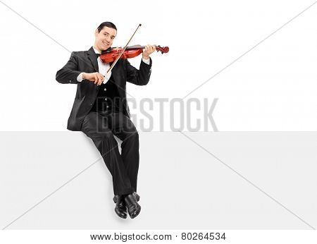 Violinist playing seated on a blank panel isolated on white background
