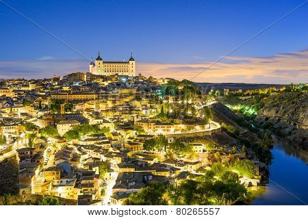 Toledo, Spain old town skyline at dawn.