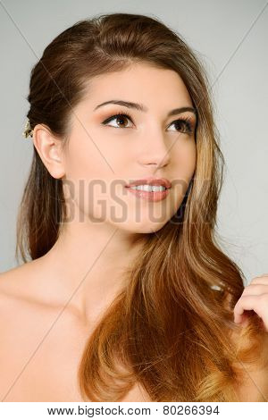Portrait of young woman with natural make-up and beautful hair. Spa girl. Skincare, healthcare. Hair, haircare. Studio shot.