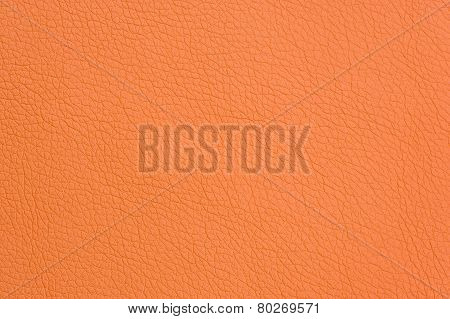Orange Artificial Leather Background Texture Close-up