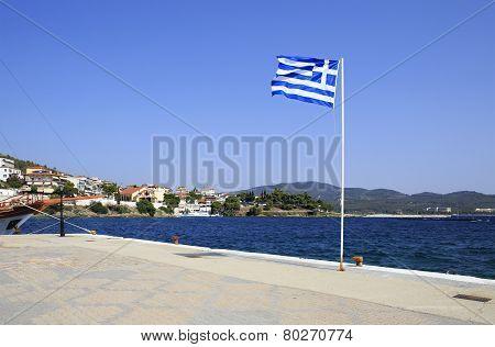 Greek flag on pier in Neos Marmaras