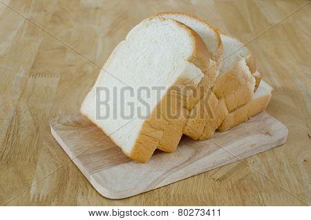 Slide Bread On Wooden Cutting Board
