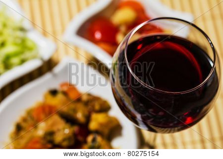 Gourmet Food With Salad. Meat Dish With Glass Of Red Wine