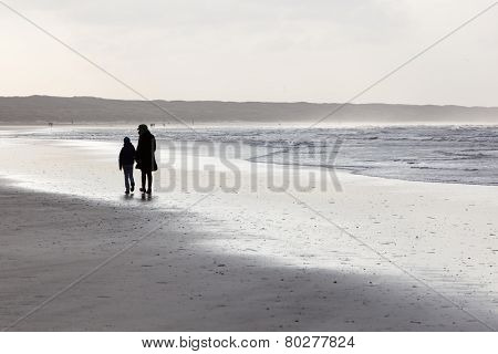 mother and child on windy beach