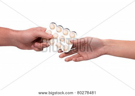 Hand giving lozenges in blister