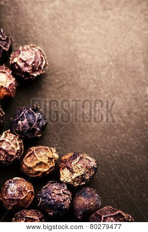 Black Peppercorns Closeup. Black Pepper On Dark Background With Copyspace