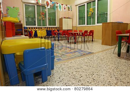 Interiors Of A Nursery Class With Colored Drawings Of Children Hanging On The Walls