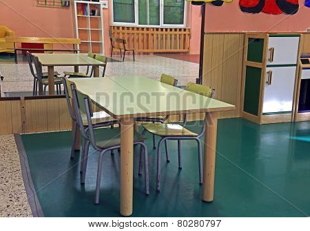Table And Chairs Of The Nursery With A Mirror On The Wall