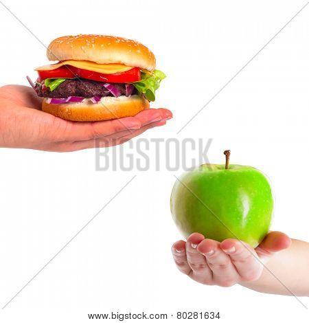 Choice between healthy apple and unhealthy hamburger