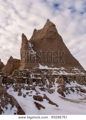 Spire In The Badlands In Winter