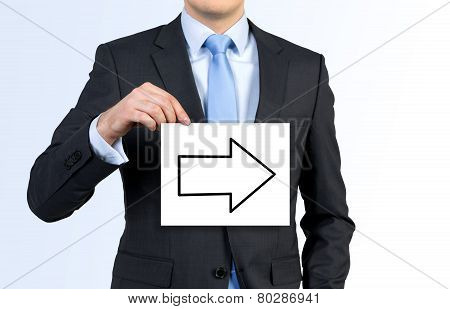 Businessman Holding Poster With Arrow