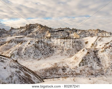 Snow-covered Peaks In The Badlands