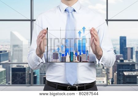 Chart And Skyscraper In Hand