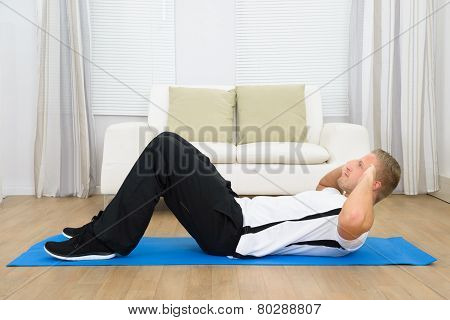 Sporty Young Man Doing Sits-up
