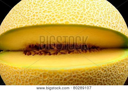 Close-up Shot Of Melon Galia Notched Isolated Black