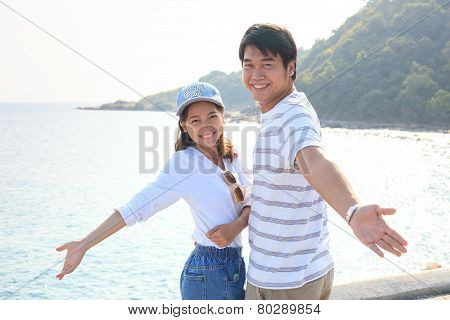 Portrait Of Young Man And Woman Relaxing And Happy Emotion On Sea Side Use For People Relax And Feel