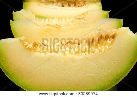 Closeup Melon Galia Slices, Pieces Isolated Black In Studio