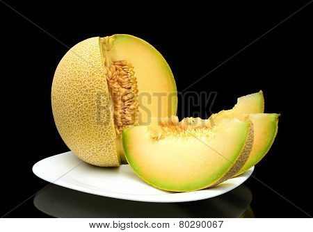 Melon Galia With Slices On Plate Isolated Black In Studio