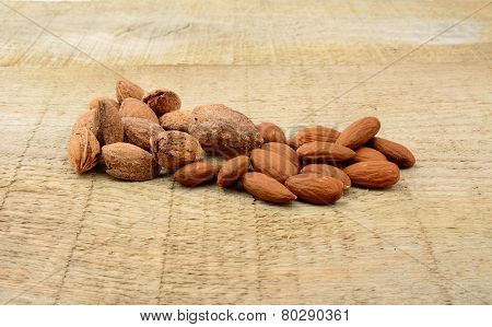 Group Of Almonds With Shell On Wooden Plank,board