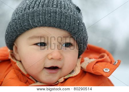 Happy Baby With Snow In Winter