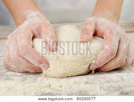 Hands In Flour Closeup Kneading Dough
