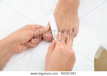 Manicurist Doing Pedicure